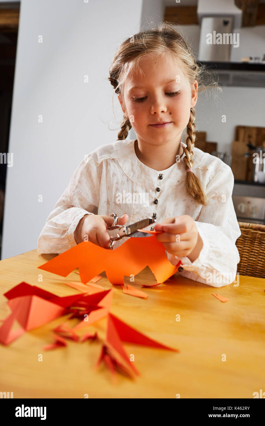 Girl cozy at home while crafting, half portrait - Stock Image