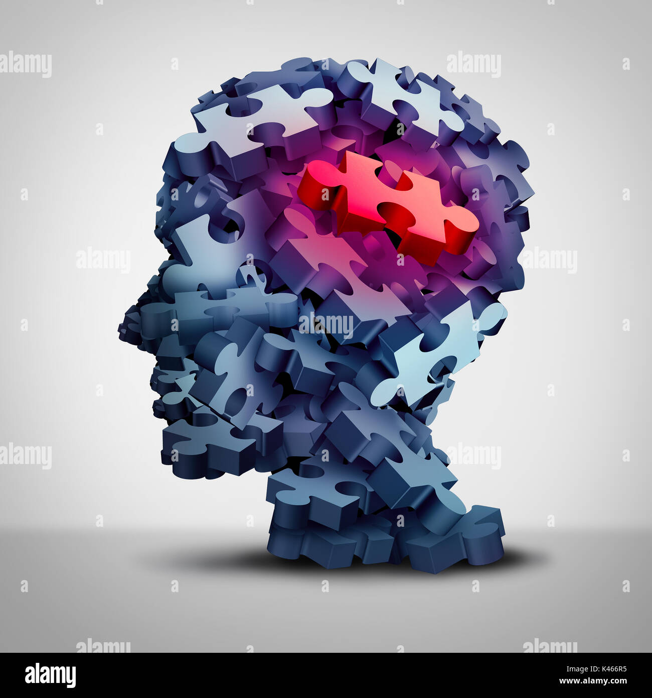 Psychiatric patient symbol and psychiatry services or psychological mental therapy concept with a group of jigsaw puzzle pieces shaped as a human. - Stock Image