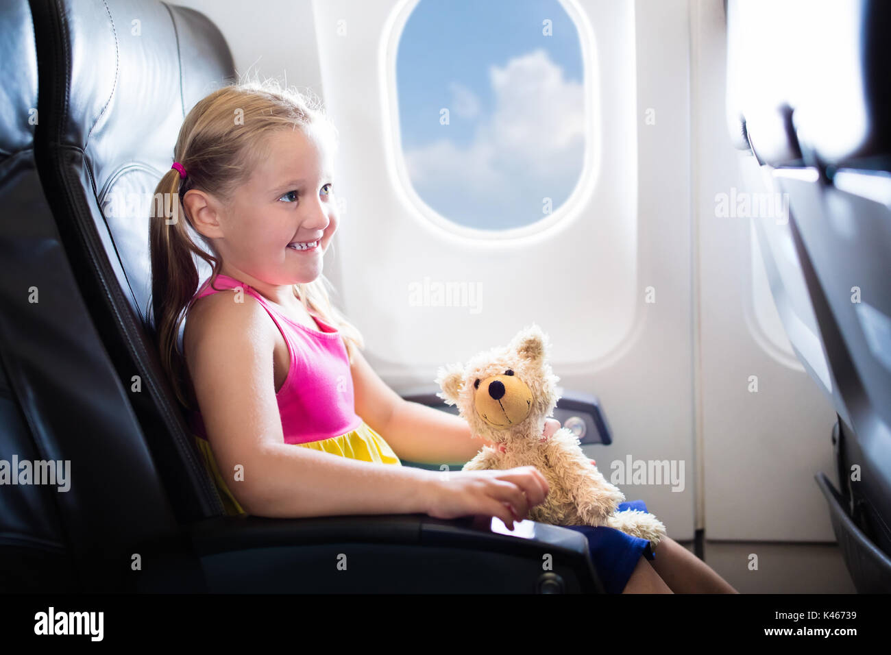 Child In Airplane Kid In Air Plane Sitting In Window Seat