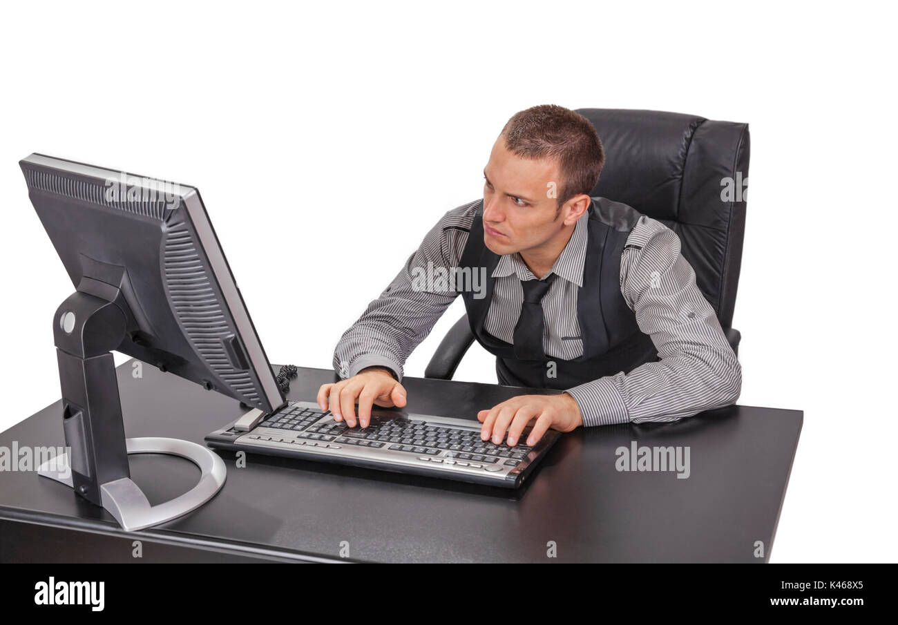 Image of a young businessman working on computer isolated against a white background. - Stock Image