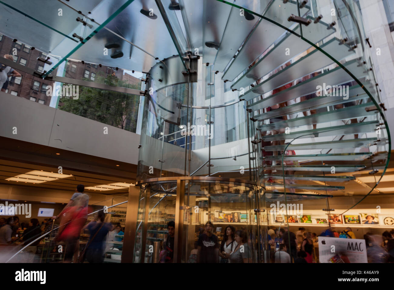 Tourists in the famous glass stairs of the the cube, Apple Store in 5th avenue, Manhattan, New York City. Stock Photo