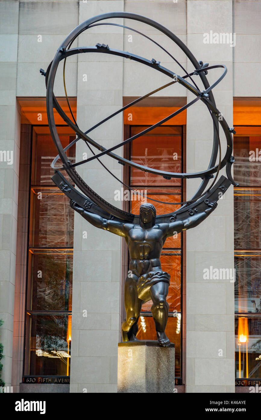 The bronze statue by Lee Lawrie (1937) Atlas holding the heavens at the facade of the Rockefeller Center in fifth Stock Photo