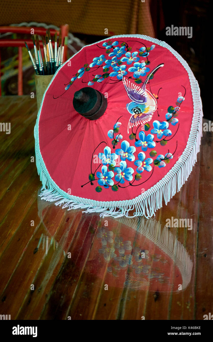 Umbrella art. Decorative painted umbrellas. Thailand craft center. Thai craftsmanship. Southeast Asia. Thailand industry - Stock Image