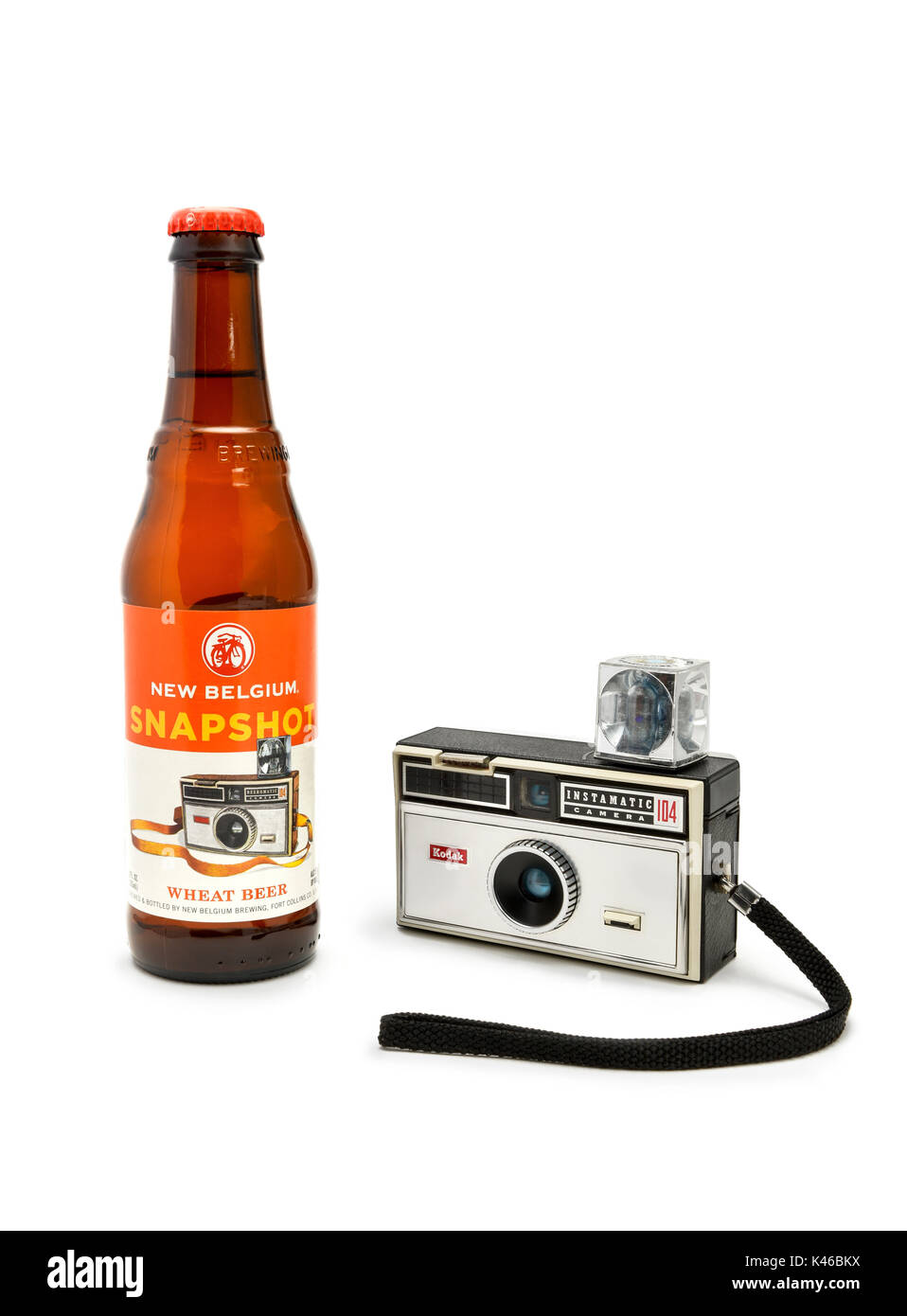 Vintage Kodak Instamatic 104 film camera from the 1970's posed with a New Belgian Snapshot Beer. - Stock Image