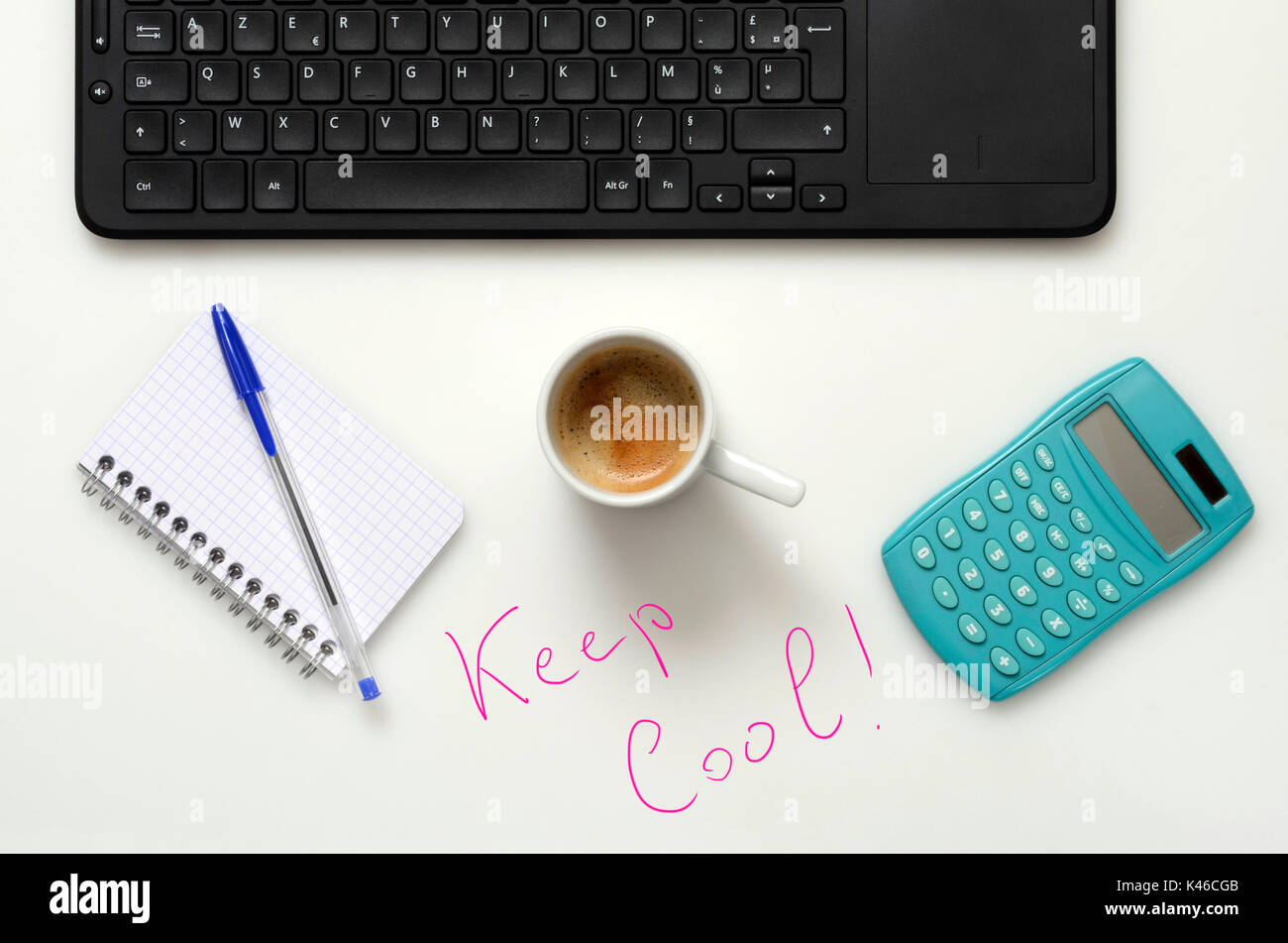 Office : PC keyboard, notebook, calculator and coffee cup for good  work and keep cool - Stock Image