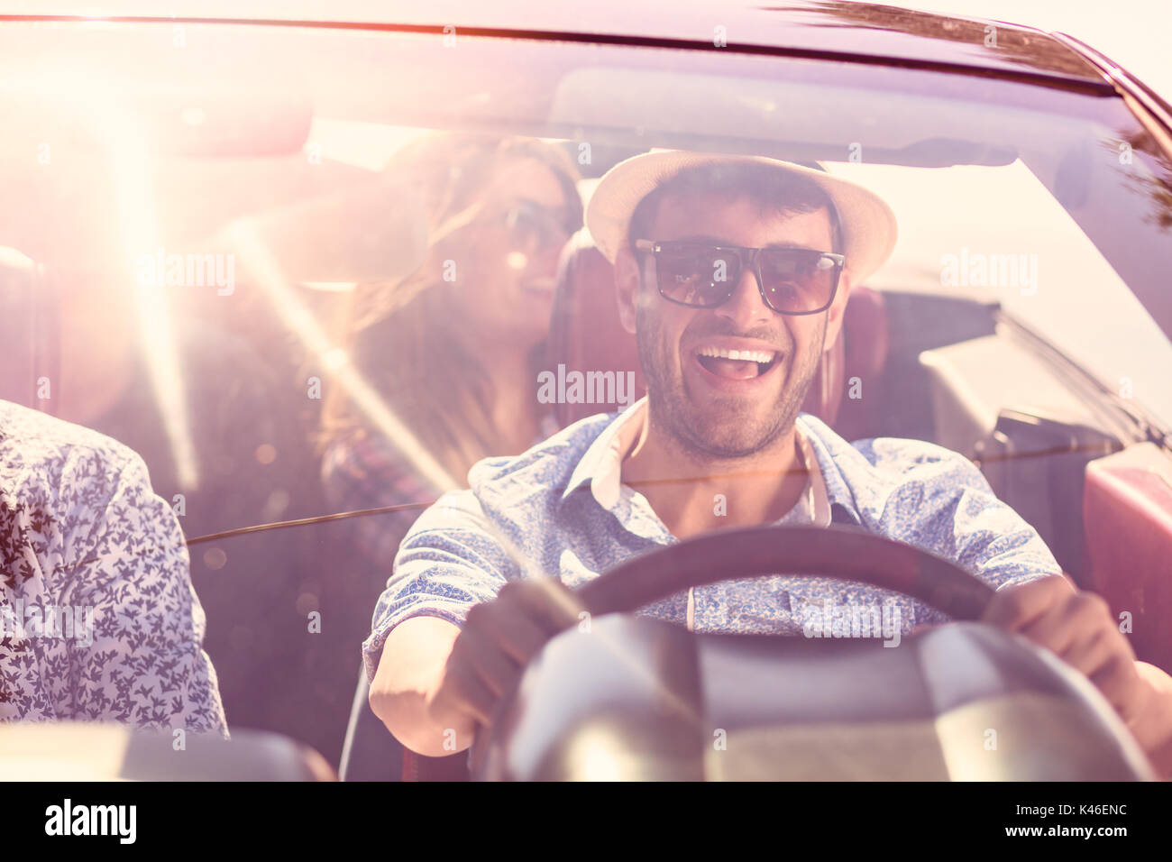 Beautiful party friend girls dancing in a car on the beach happy - Stock Image
