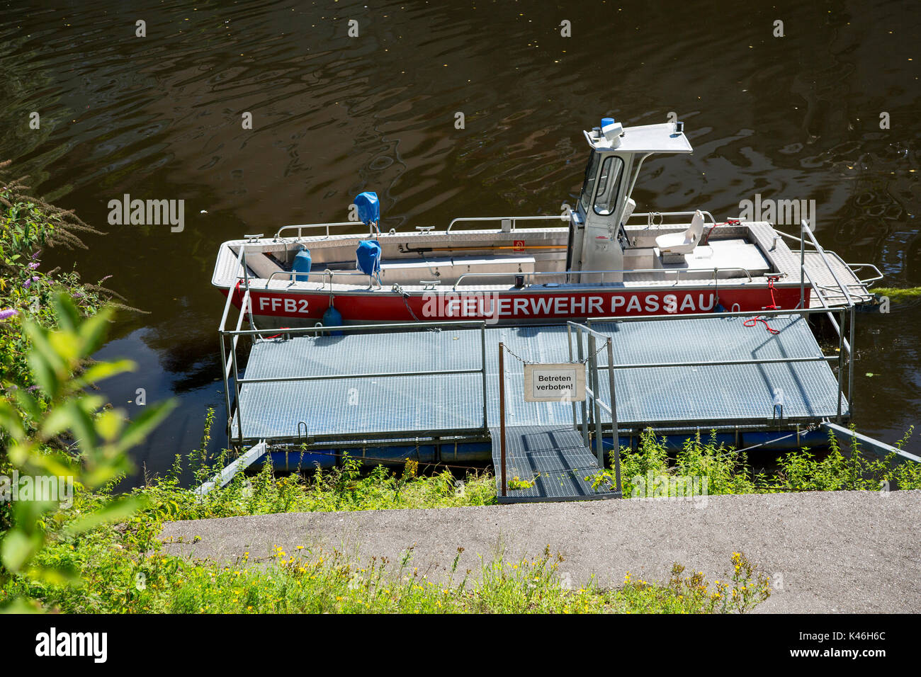 A fire service (Feuerwehr) river rescue boat moored on the river Danube in Passau, Bavaria, Germany. - Stock Image