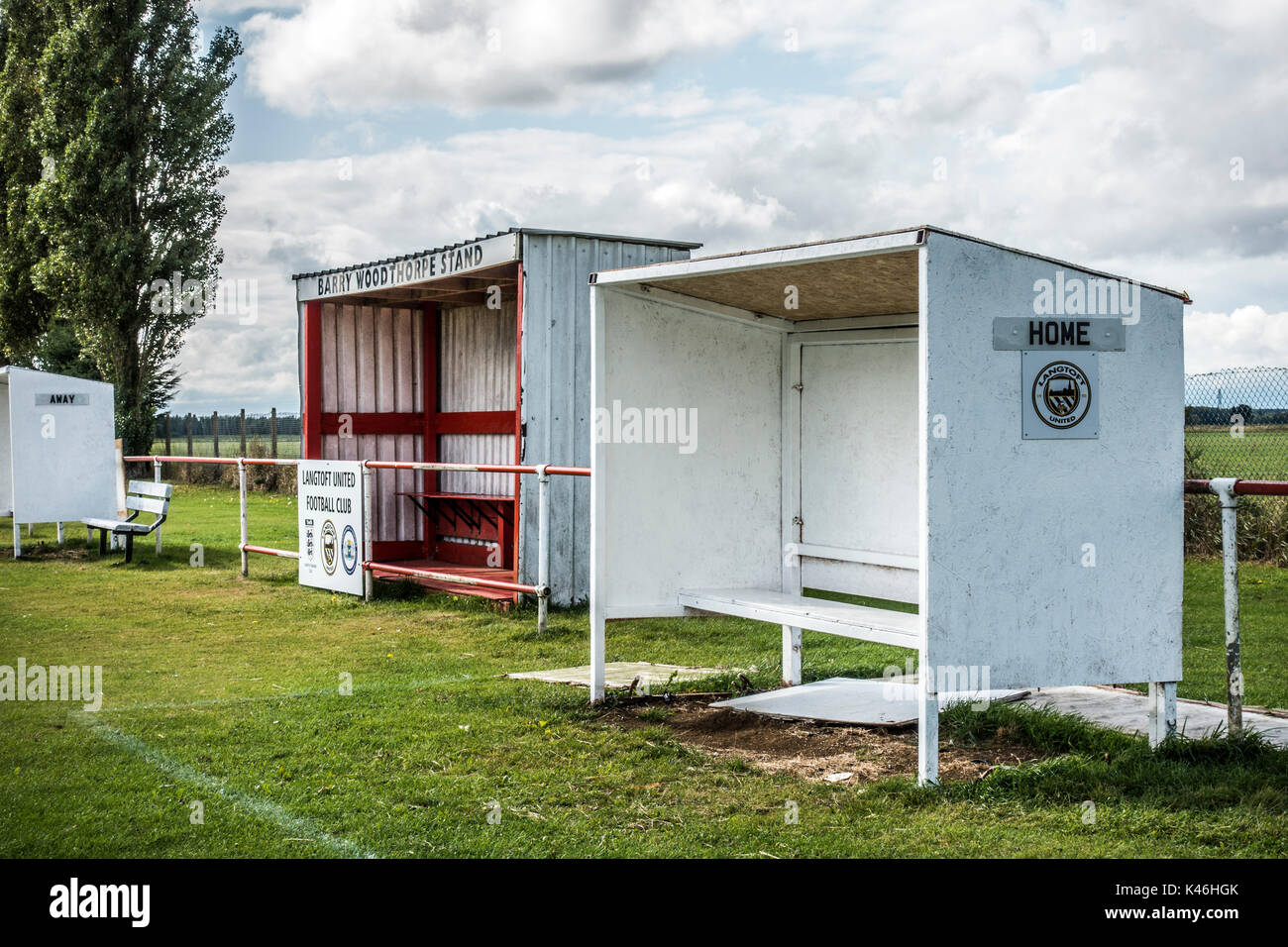 Grass roots football. Basic shelters and match stand for teams and personnel. Langtoft United Football Club home ground, England, UK. - Stock Image
