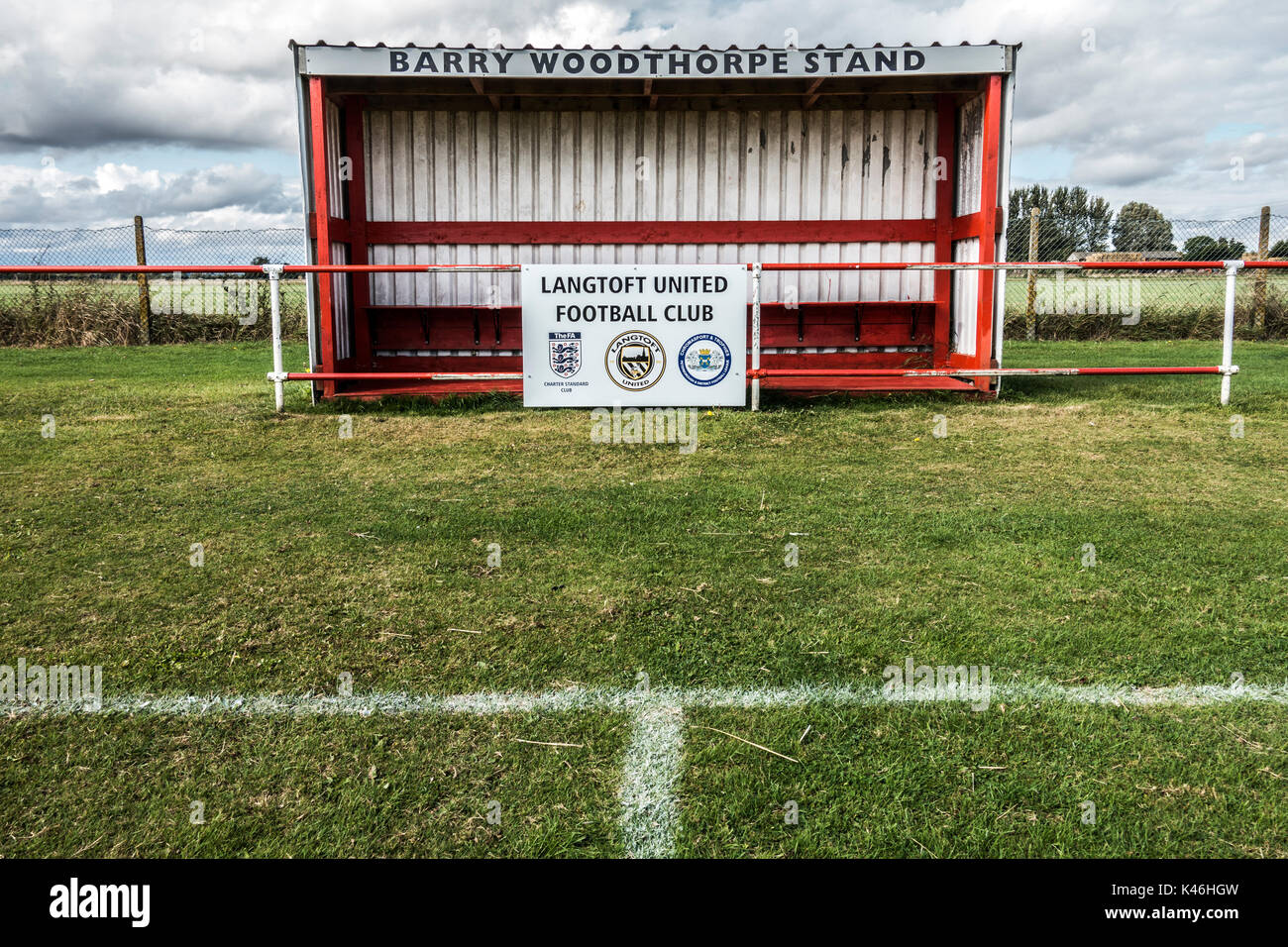 Grass roots football. Basic corrugated metal match stand for team personnel. Langtoft United Football Club home ground, Lincolnshire, England, UK. - Stock Image