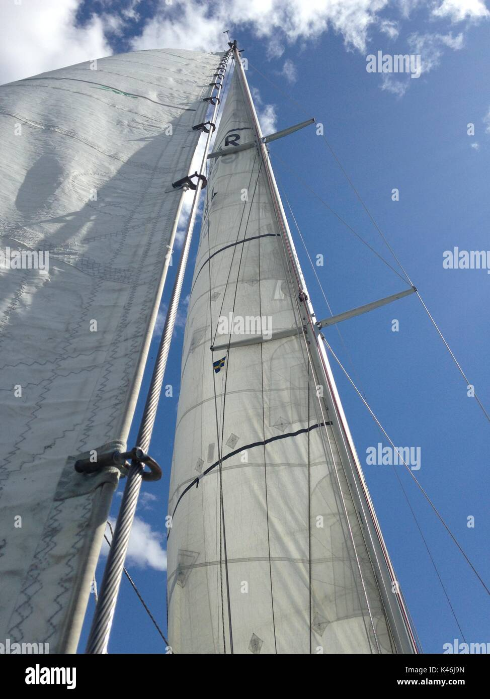 Sailing on a sunny day, white sails against a blue sky - Stock Image