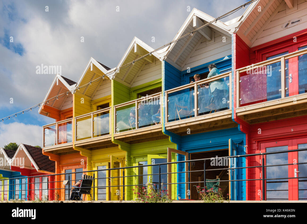 The colourful beach huts in Scarborough's North Bay - Stock Image
