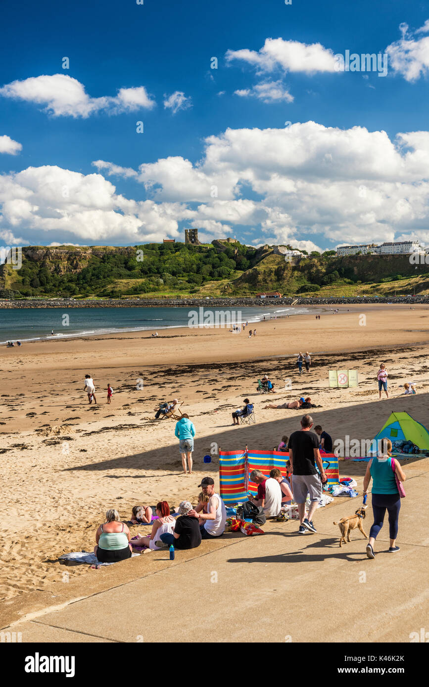 Visitors on the beach at Scarborough's South Bay - Stock Image