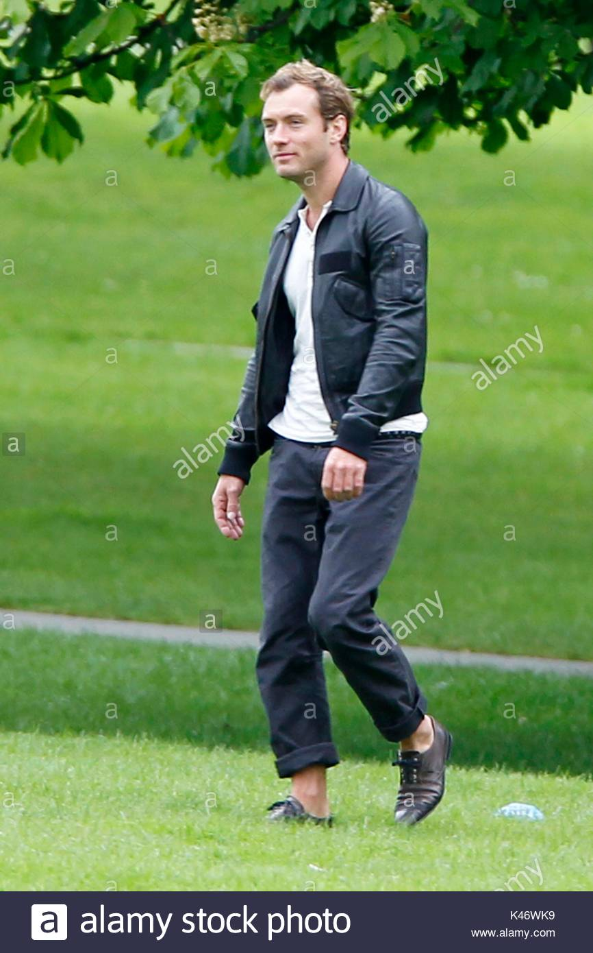5191031444f9 Wearing a black leather jacket and shoes with no socks actor jude law takes  a stroll