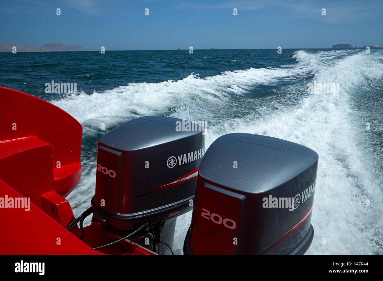 Outboard motors on tourist boat on Ballestas Islands Tour, Pisco Province, Ica Region, Peru, South America - Stock Image