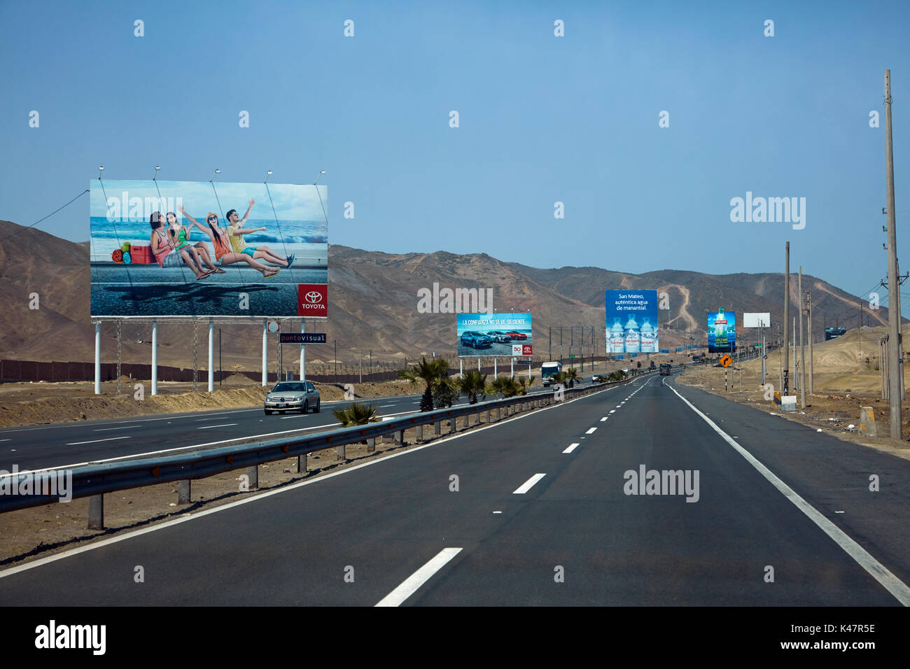 Pan-American Highway and billboards south of Lima, Peru, South America - Stock Image