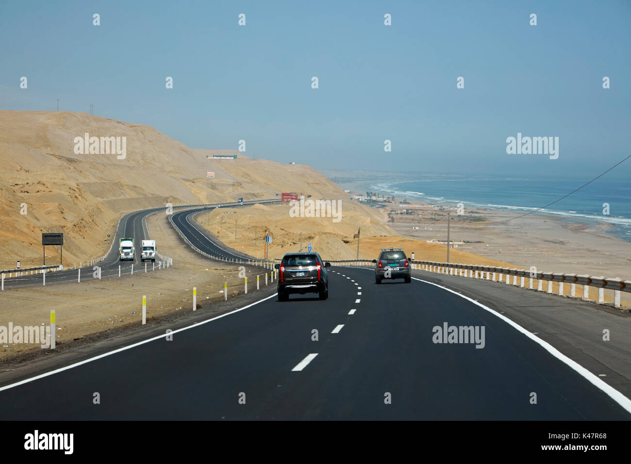 Pan-American Highway along desert and Pacific coast south of Lima, Peru, South America - Stock Image