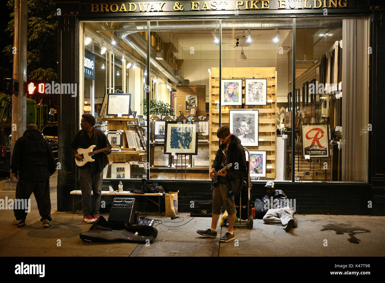 SEATTLE, WA, USA - JUNE 2016 - Unidentified Rock band playing at late hours at night in the side walk. - Stock Image