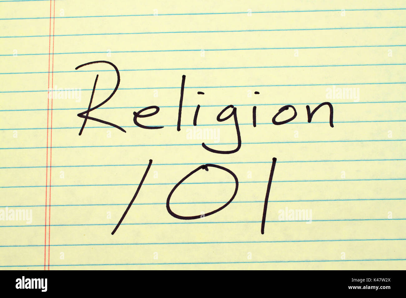 The words 'Religion 101' on a yellow legal pad - Stock Image