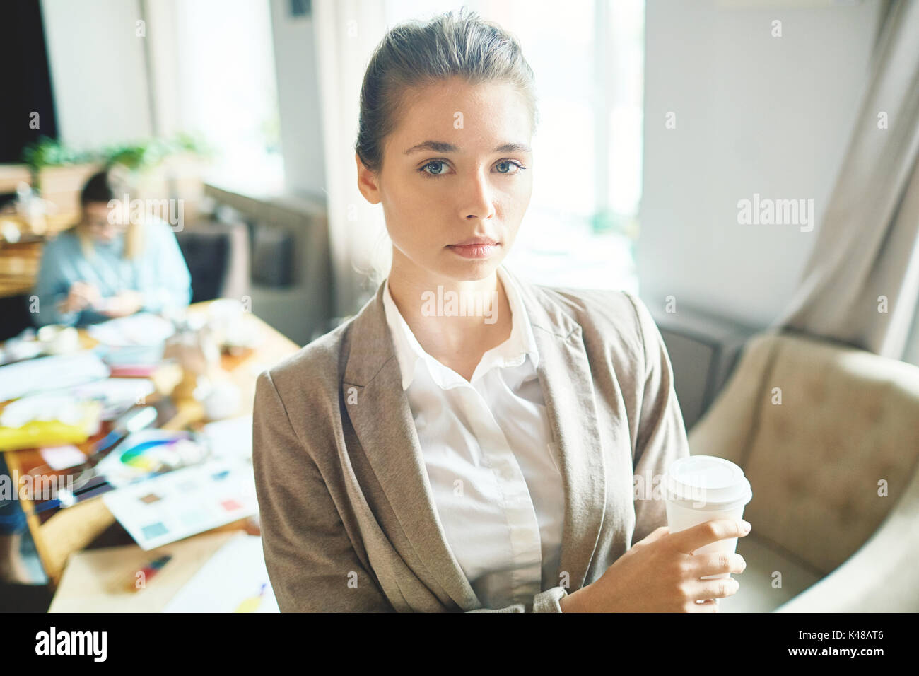 Pretty Entrepreneur at Open Plan Office - Stock Image