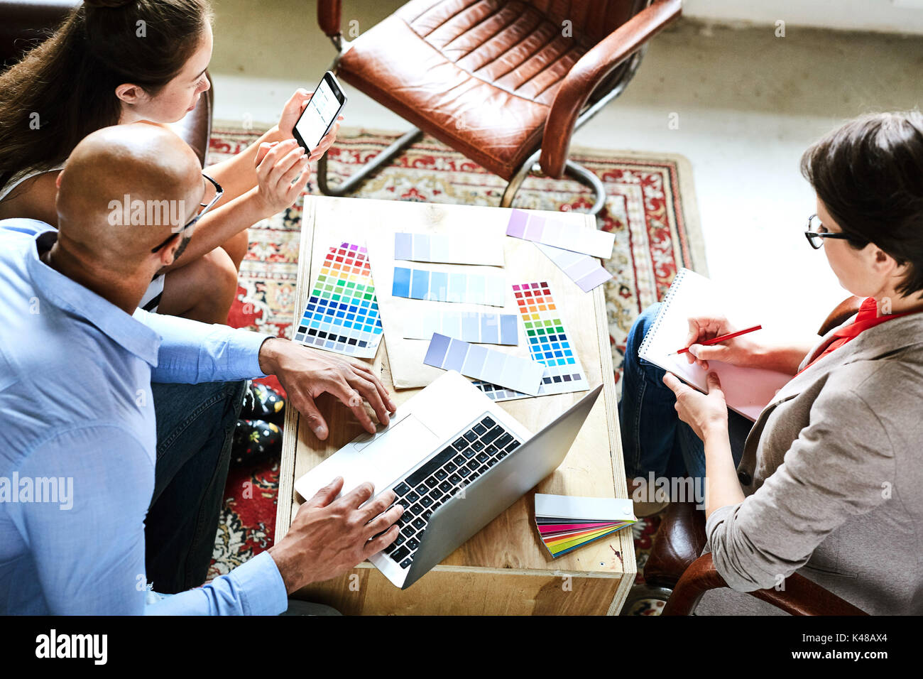 Having Project Discussion with Colleagues - Stock Image