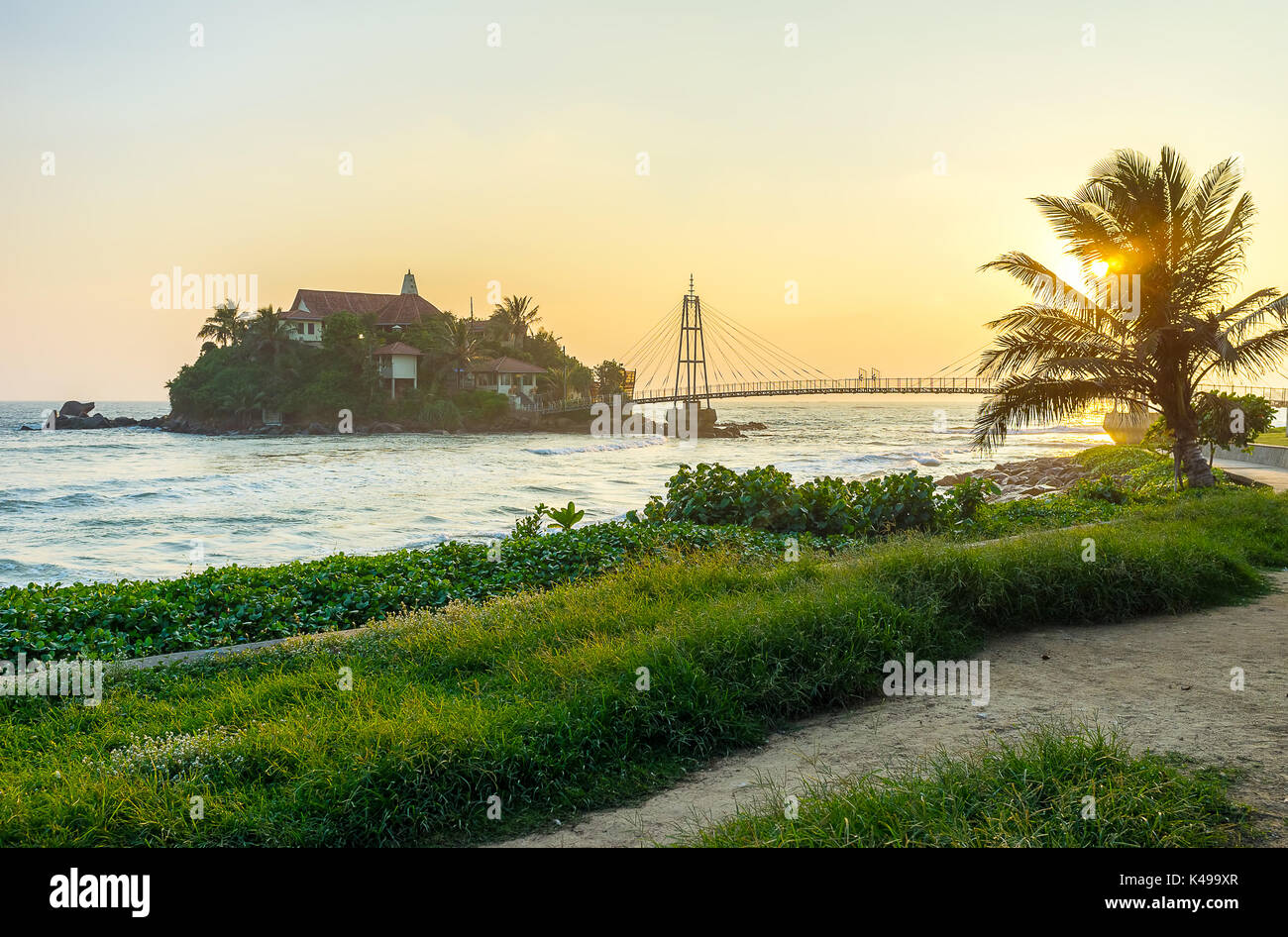 Sunset is the most romantic period of the day and is the best time for leisure walks along coastline enjoying beautiful views on Indian Ocean, Matara - Stock Image