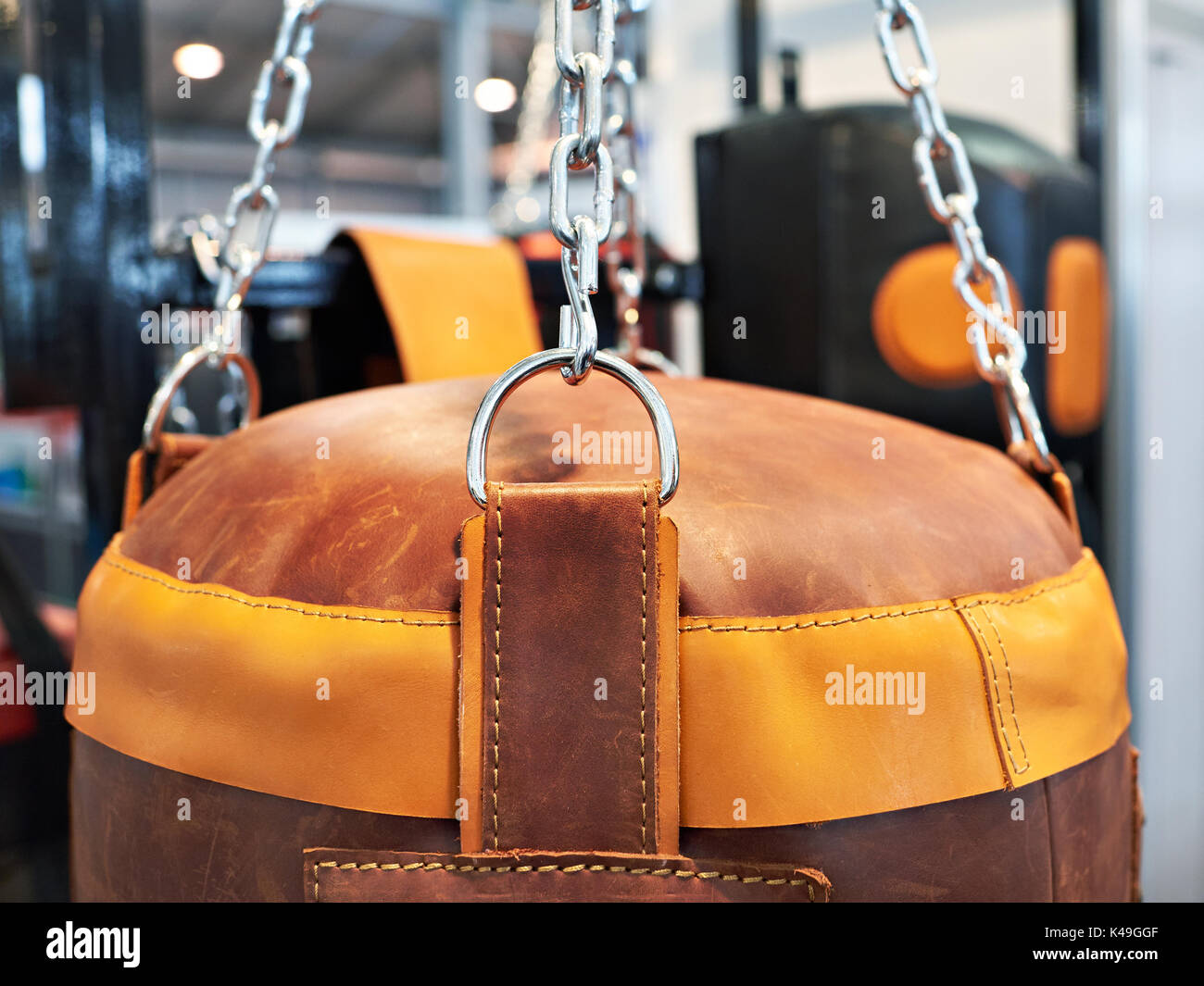 Leather Punching bag on chains - Stock Image