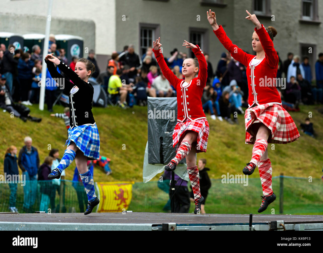 Girls In Kilted Skirts At A Folkloric Dance Performance, Ceres, Scotland, United Kingdom - Stock Image