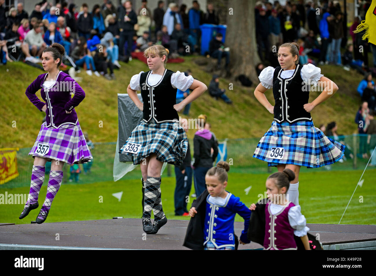 Girls In Kilted Skirts Performing At The Highland Dancing Competition At The Ceres Highland Games, Scotland, Great Britain - Stock Image