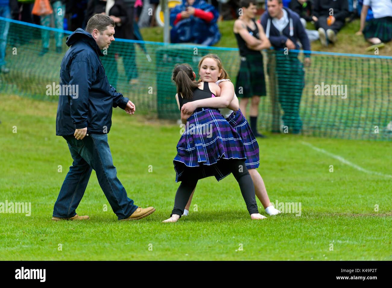 Female Scottish Backhold Wrestlers In Action, Ceres Highland Games, Ceres, Scotland, Uk - Stock Image