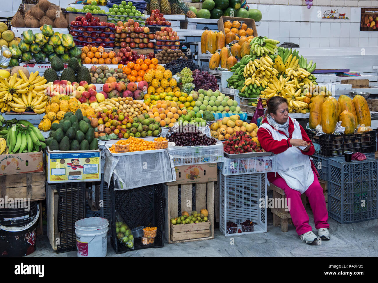 Colorful Fruit Stand With Exotic Fruits On Display, Inaquito Market Food Court, Quito, Ecuador Stock Photo