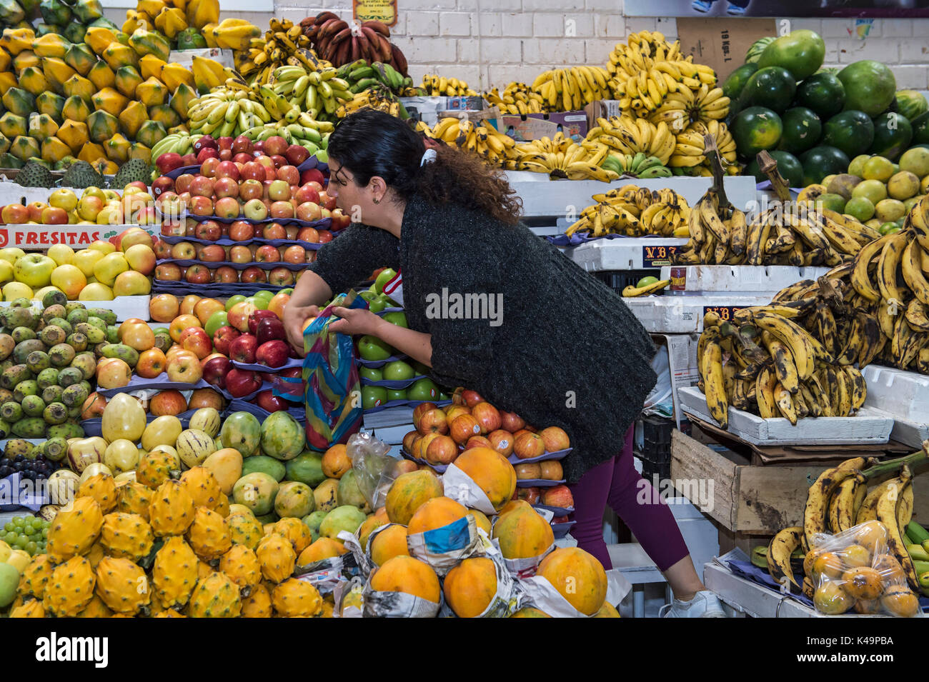 Colorful Fruit Stand With Exotic Fruits On Display, Inaquito Market Food Court, Quito, Ecuador - Stock Image