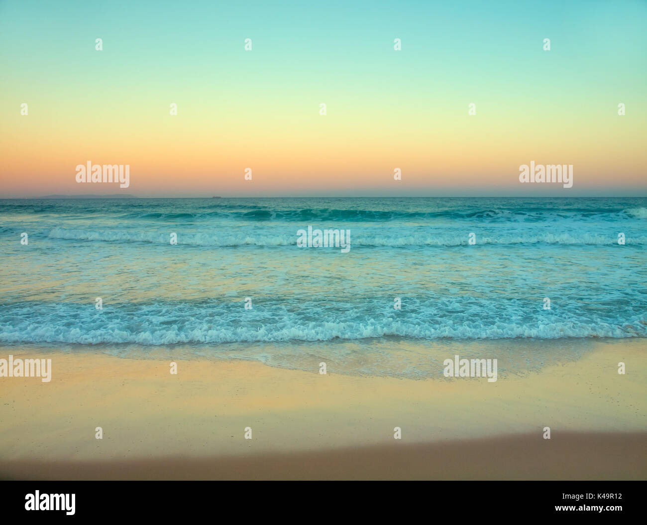 Retro Styled, Instant Camera Style Photo Of A Beach During Sunrise, Dawn - Stock Image