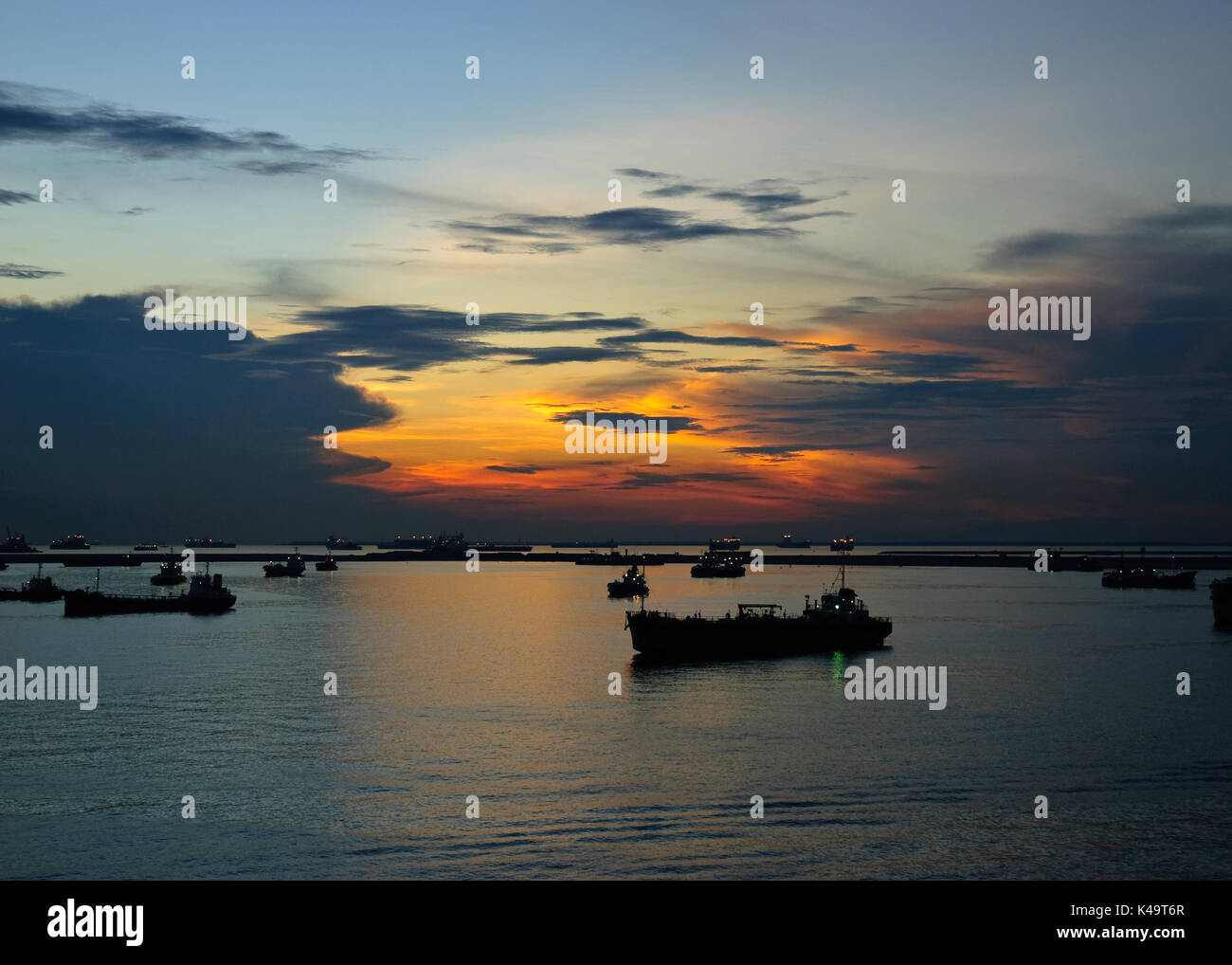 Ships at Sunset at Singapore Western Anchorage - Stock Image