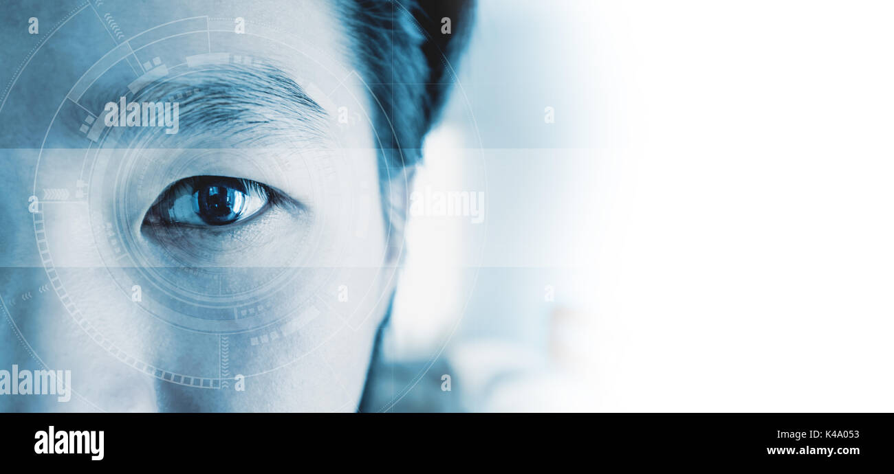 Panoramic close-up Asian businessman's eye , with futuristic technology visual effect, with white copy space - Stock Image