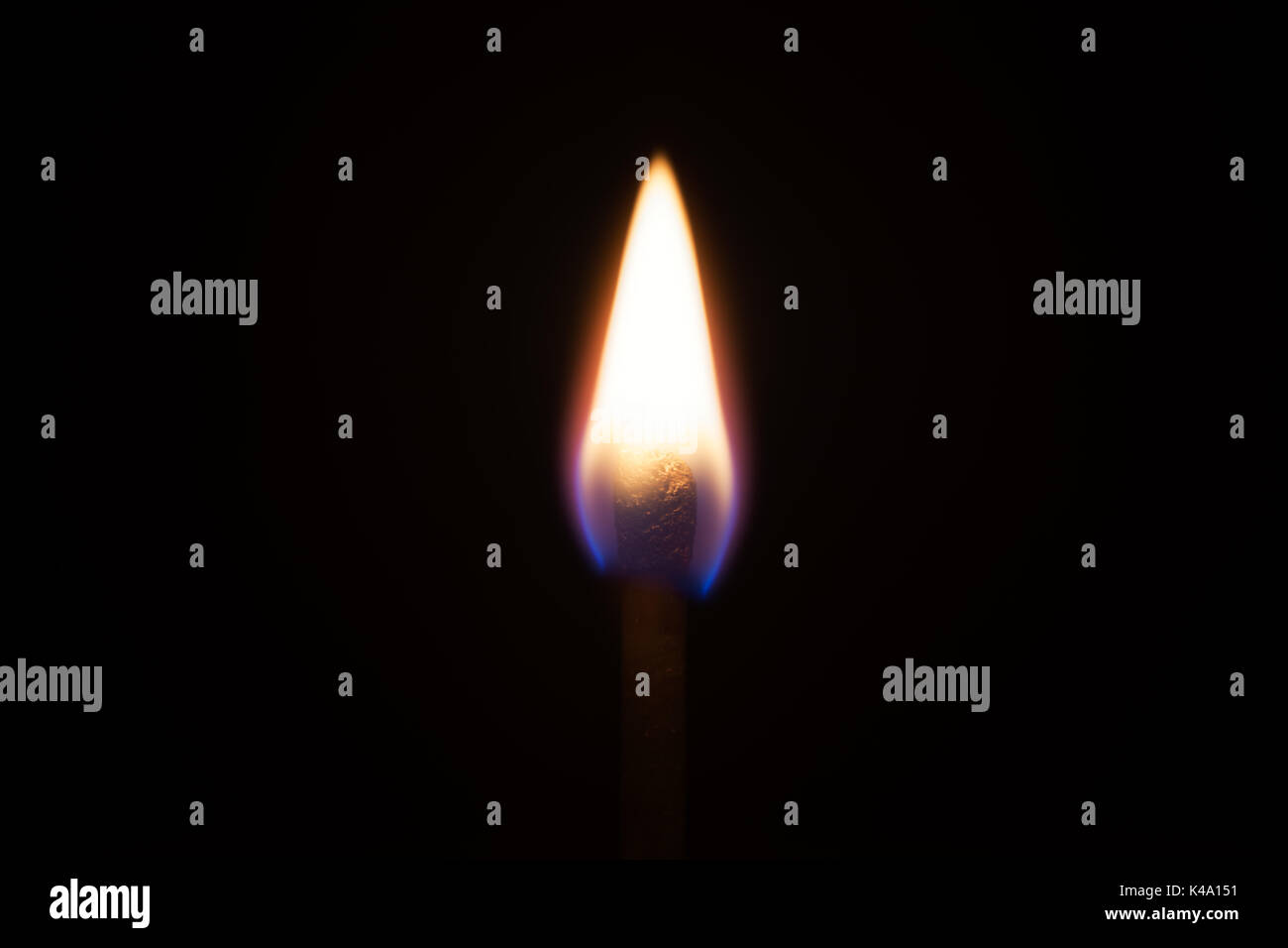 Closeup of a fire on black background - Stock Image