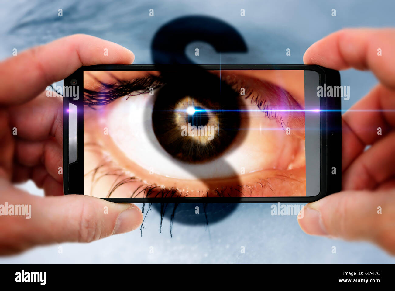 Womans Eye And Paragraph Sign In A Cellphone, Gawker Stock Photo