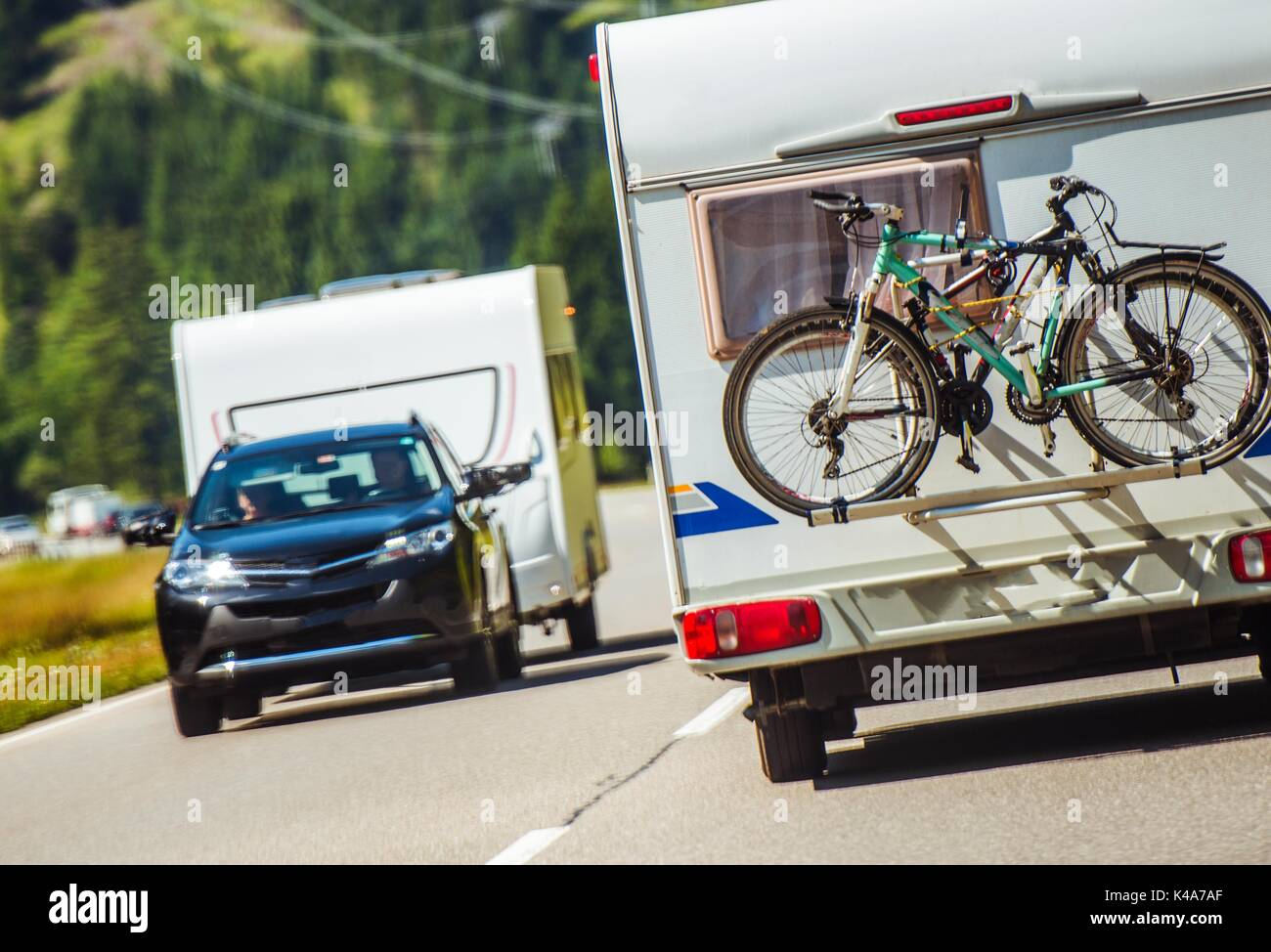 Campers Peak Season. Travel Trailers and Campers on the Road. Heavy Vacation Traffic. - Stock Image