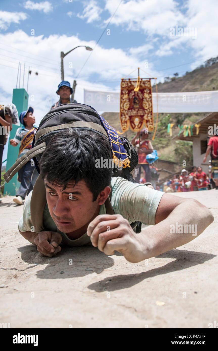 A pilgrim doing penance for the festivity of the 'Cristo Cautivo de Ayabaca' (Montero, Peru). - Stock Image