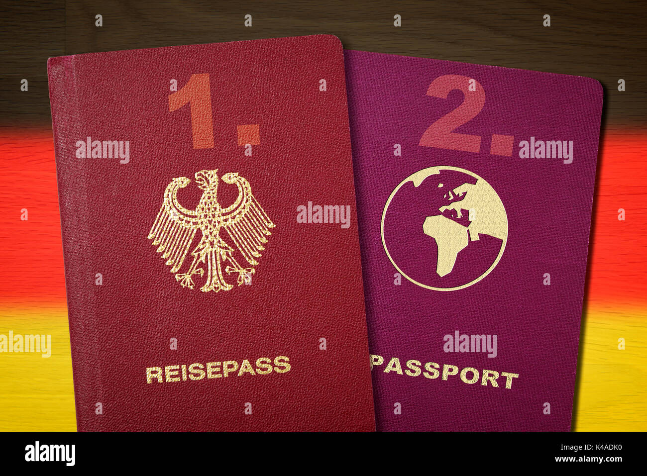 Two Passports In Front Of German National Colours, Dual Citizenship - Stock Image