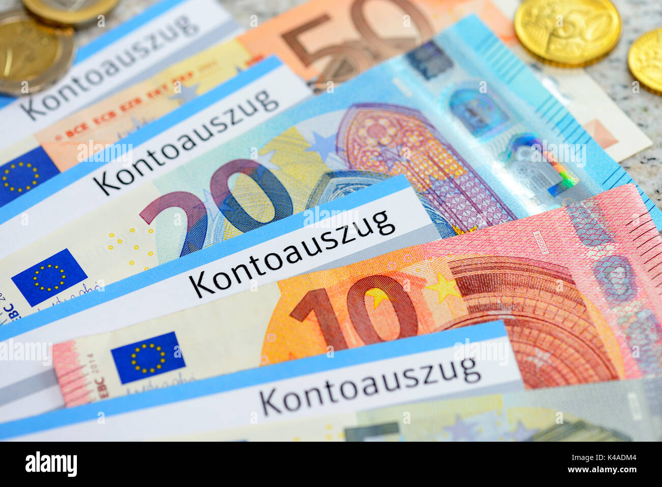Bank Statements And Euro Banknotes And Coins - Stock Image