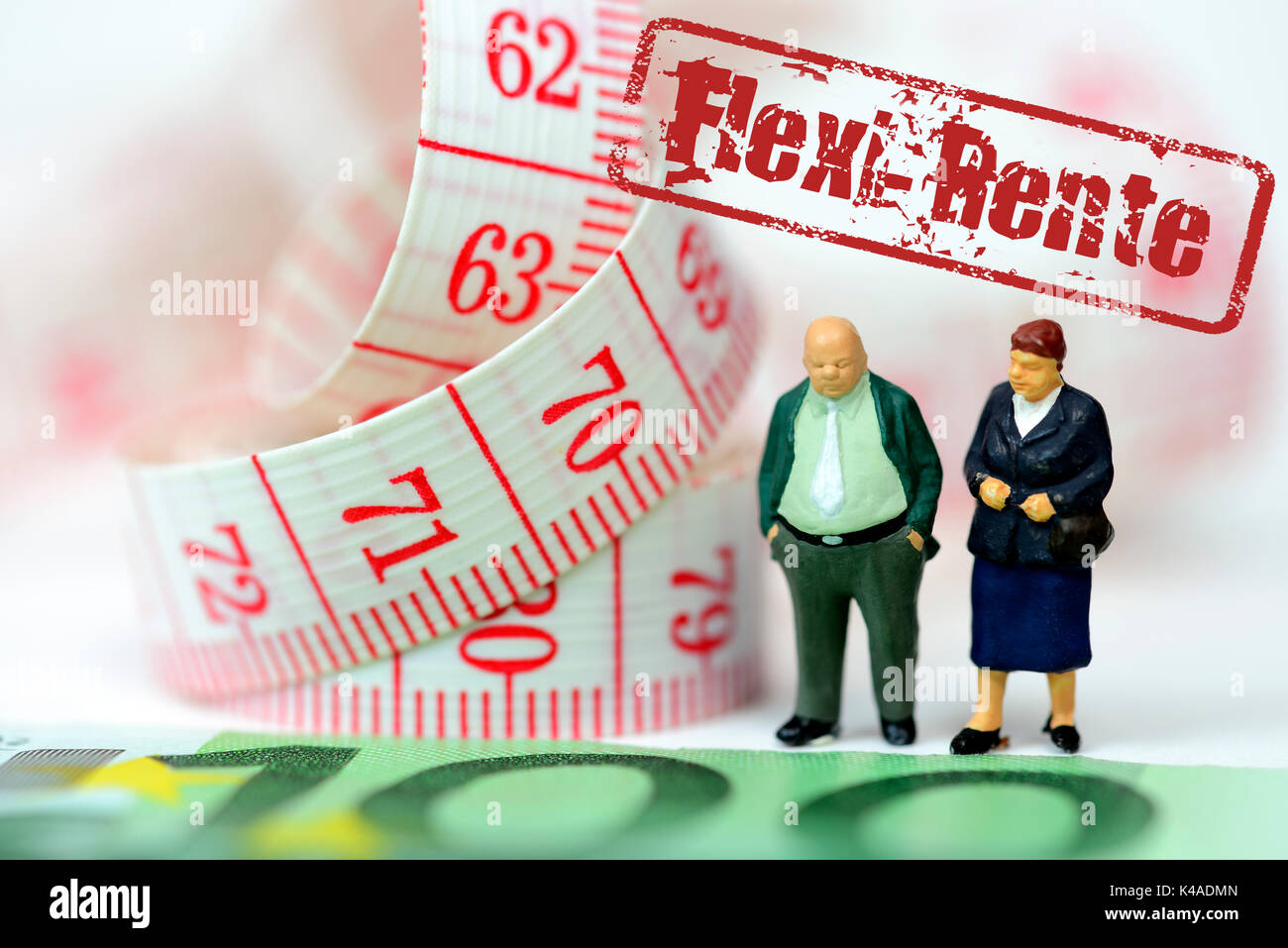 Old Couple Miniatures, Euro Banknote And Measuring Tape Stock Photo