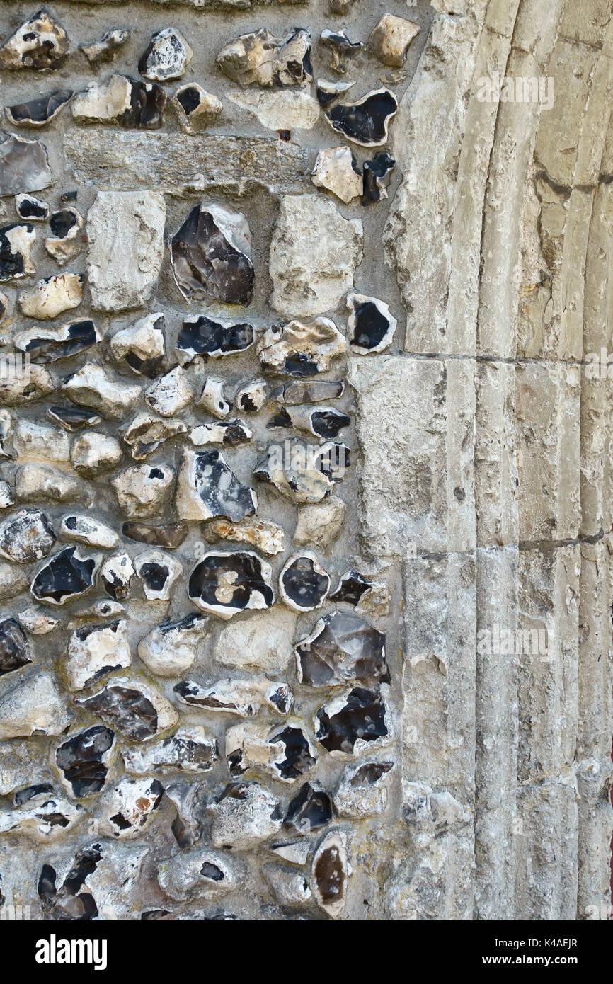 Odiham, Hampshire, UK. All Saints Church. Medieval flint wall - Stock Image