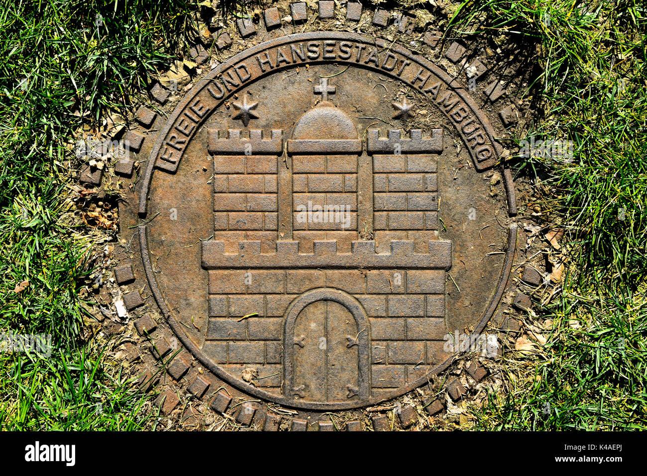Hamburg Coat Of Arms On Manhole Cover - Stock Image