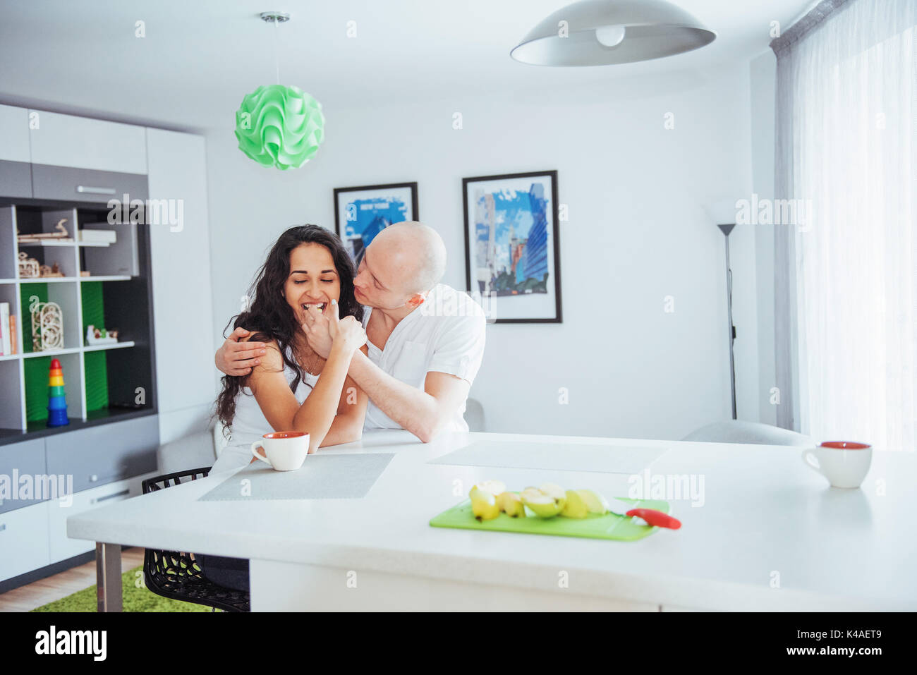 Happy young couple having coffee in the kitchen Stock Photo