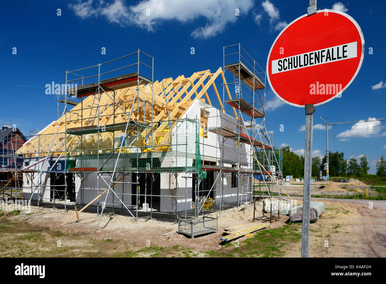 Private Housebuilding And Debt Trap Warning Sign - Stock Image