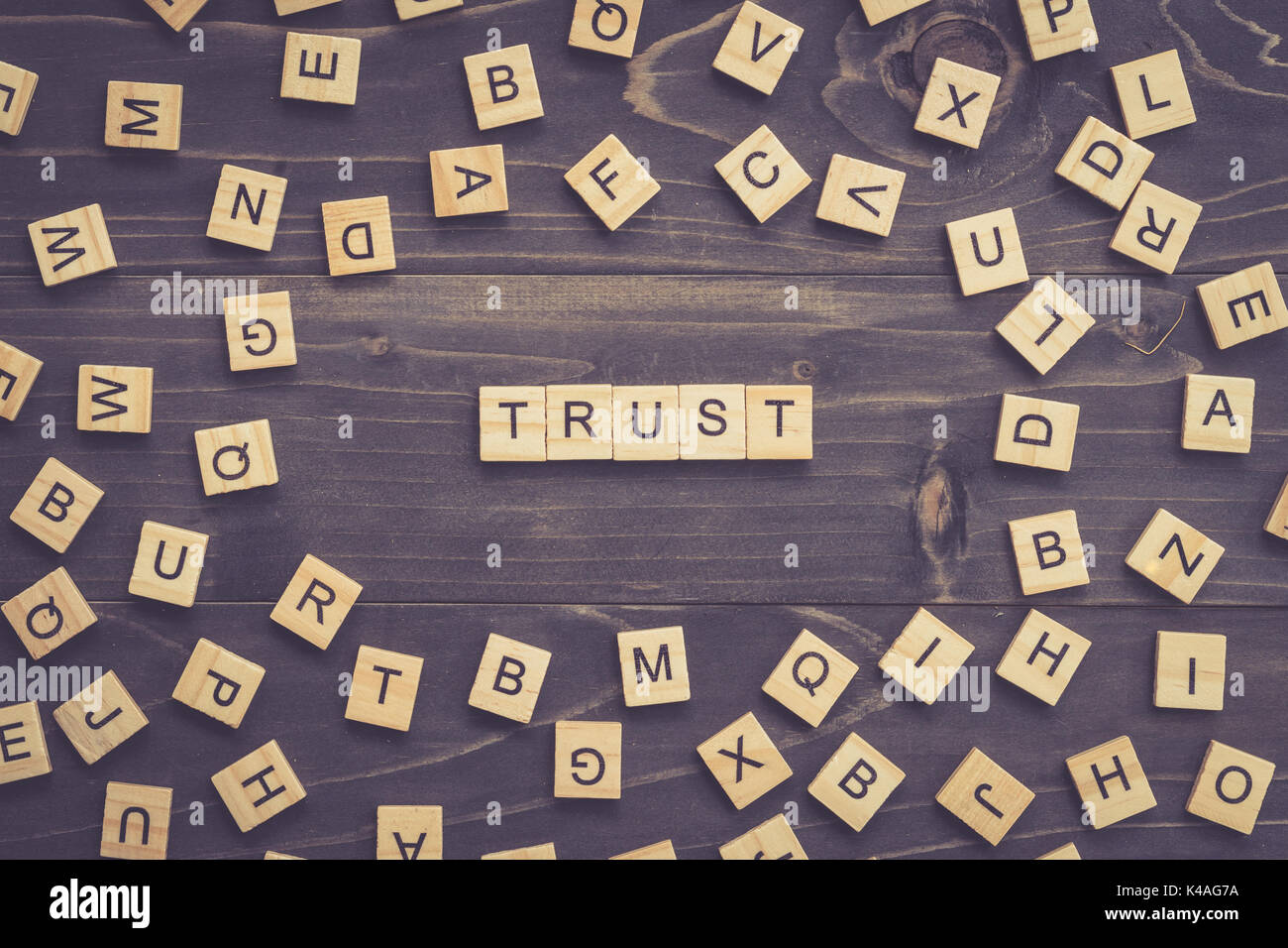 TRUST word wood block on table for business concept. - Stock Image