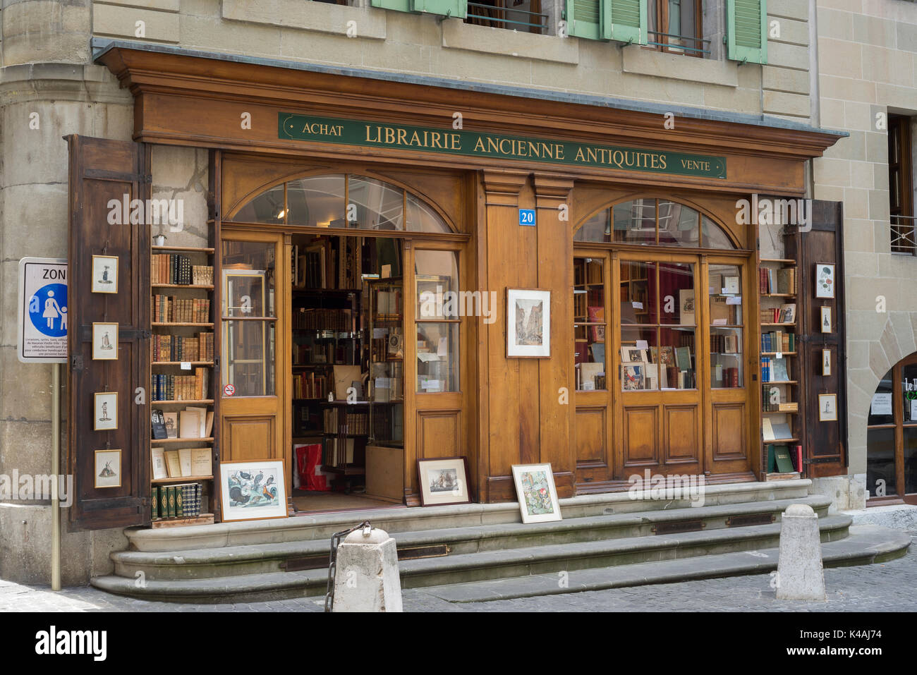 Second hand bookstore with wooden facade, Grand Rue, Old Town, Geneva, Switzerland Stock Photo