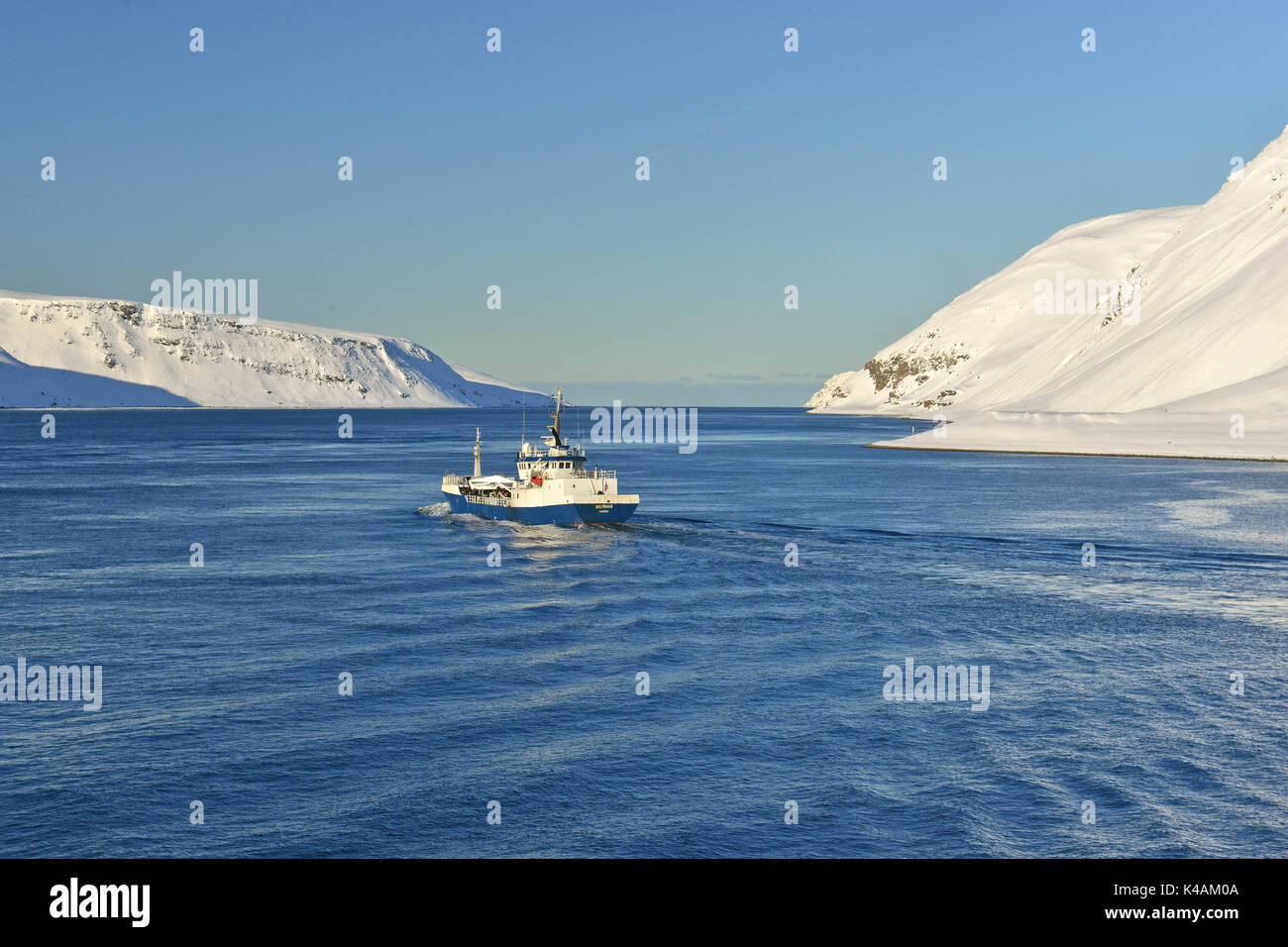 Blue-and-white ship, Meerenge, Magerøysund, Finnmark, Norway Stock Photo
