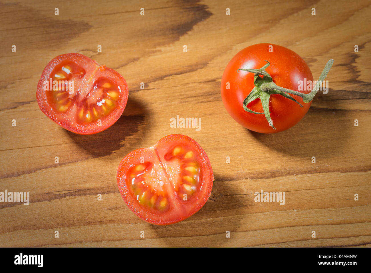 Tomatoes Against Wooden Backgroundw - Stock Image
