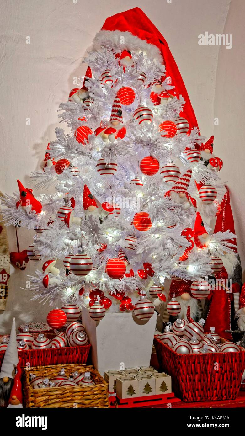 artificial christmas tree in elegant white with red and silver stock photo alamy https www alamy com artificial christmas tree in elegant white with red and silver spheres image157589274 html